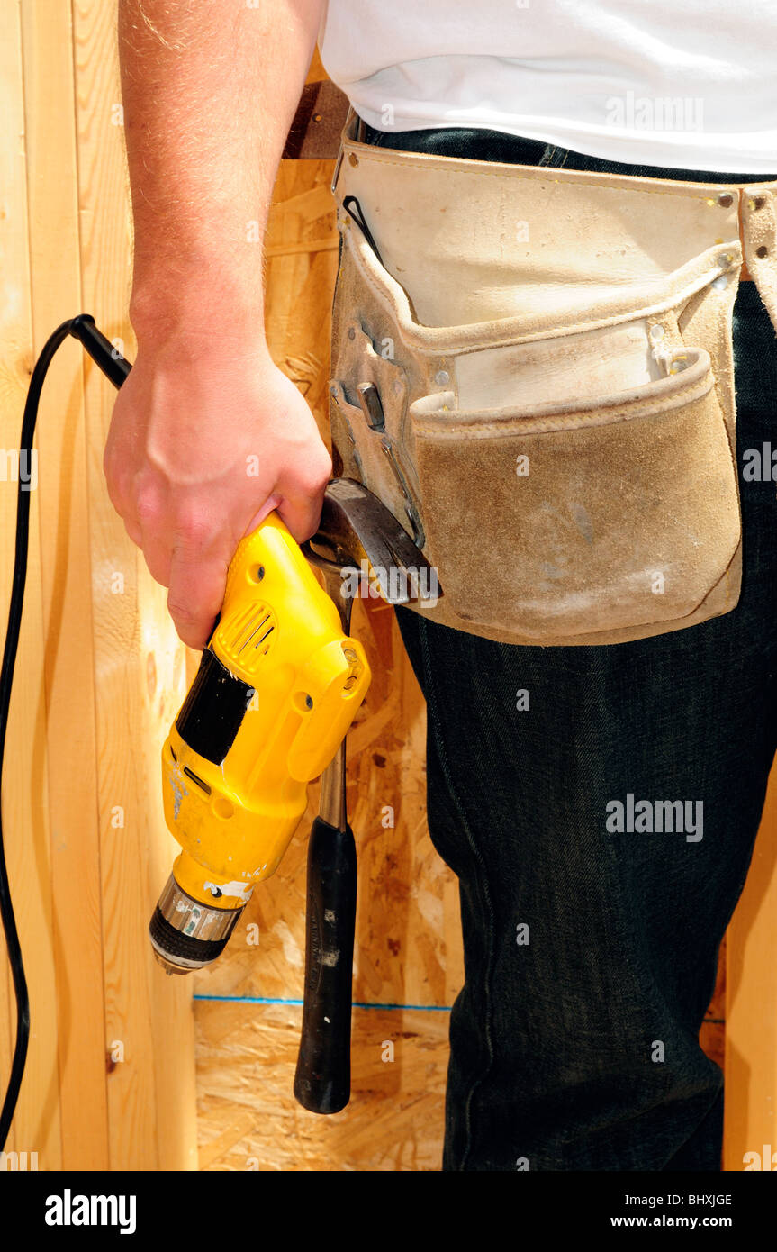 Carpenter Holding A Power Drill - Stock Image