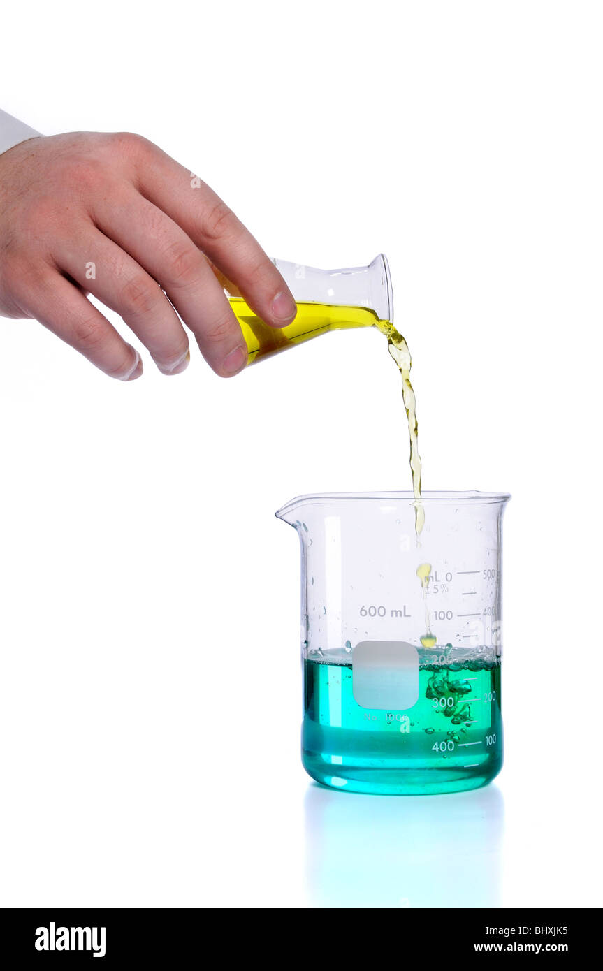 Hand pouring liquid into flak over white background - Stock Image