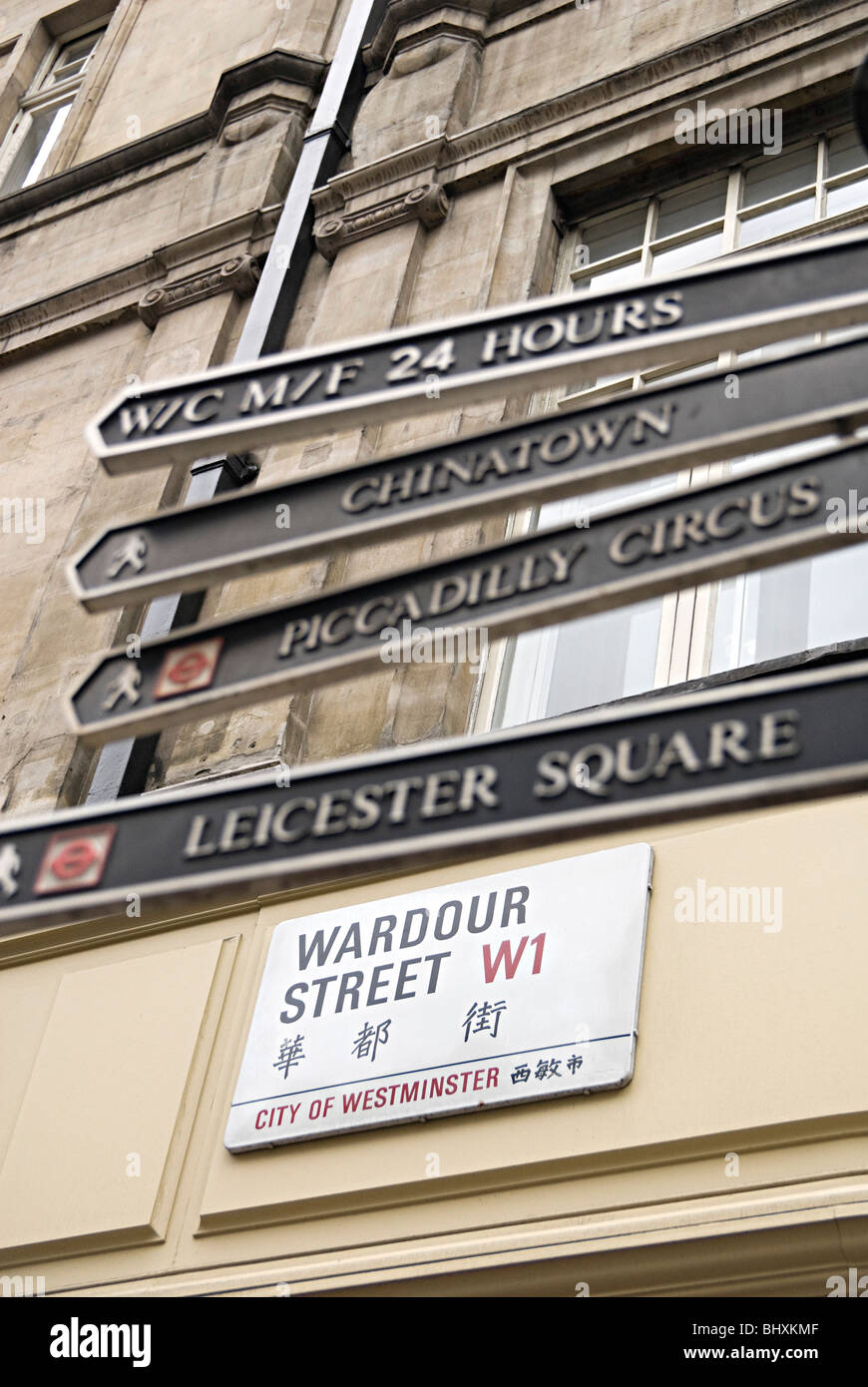 sign in london on wardour street with china town Leicester square, Piccadilly square and toilet directions - Stock Image