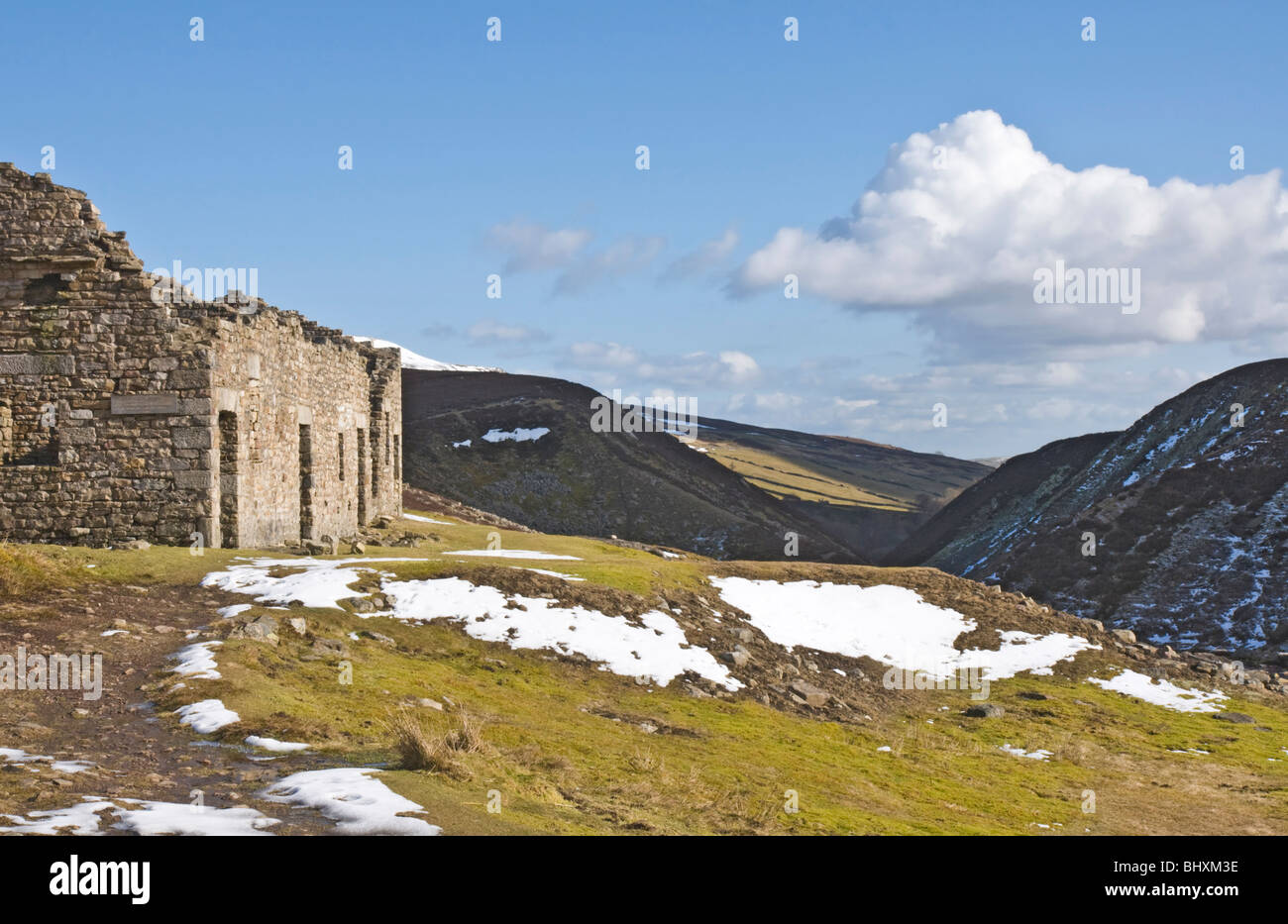 The ruins of Surrender Smelt Mill, Swaledale, Yorkshire Dales National Park. Part of the remains of the Lead Mining - Stock Image