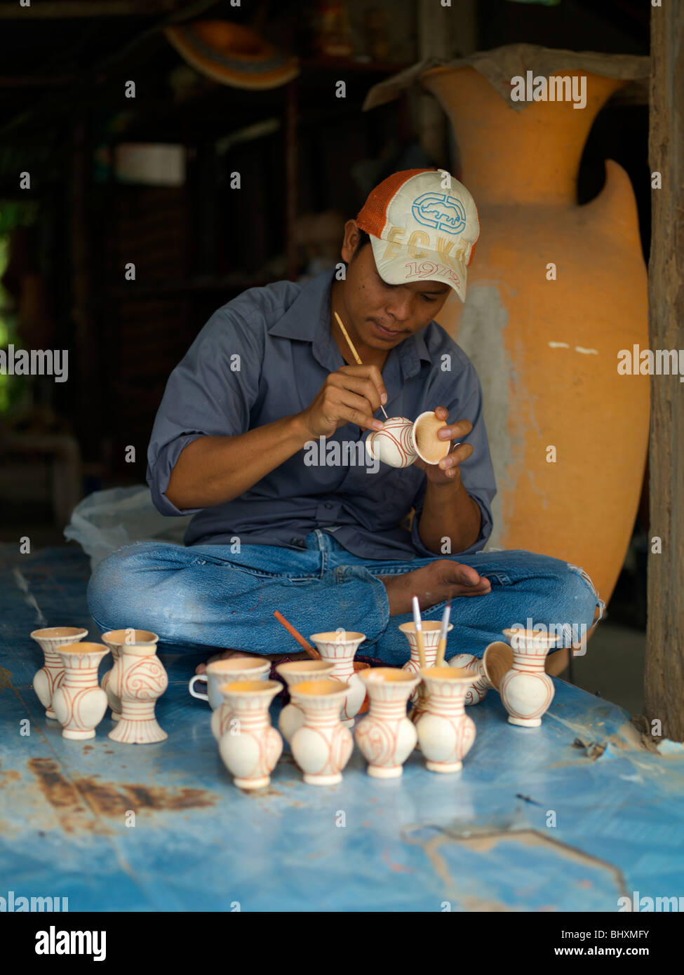 Jug maker painting the distinction design in Ban Chiang, Udon Thani, Thailand - Stock Image