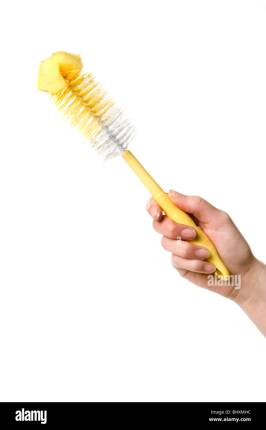 hand holding brush - Stock Image