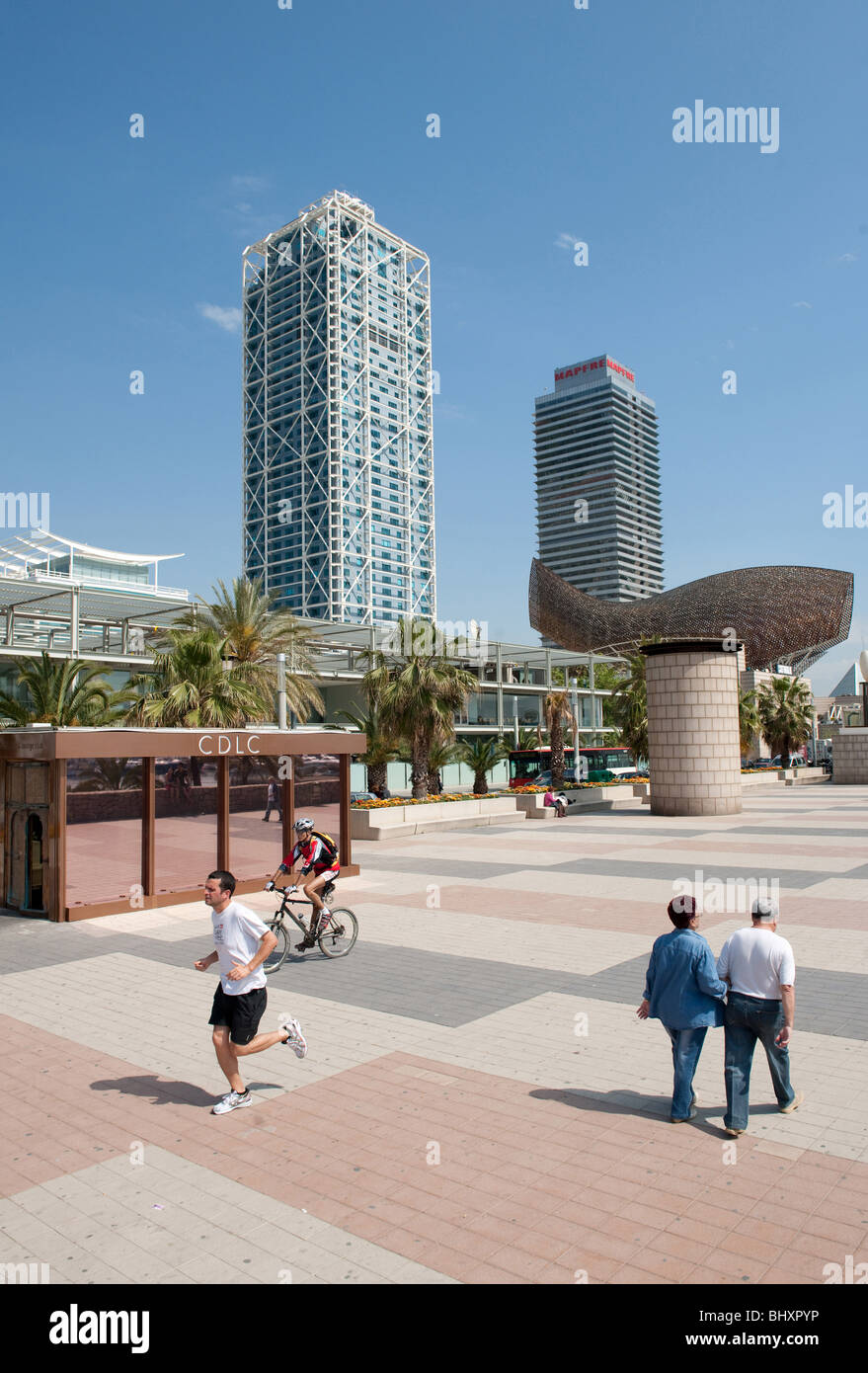 Port Olimpic, promenade with copper fish by Frank Gehry Barcelona Spain - Stock Image