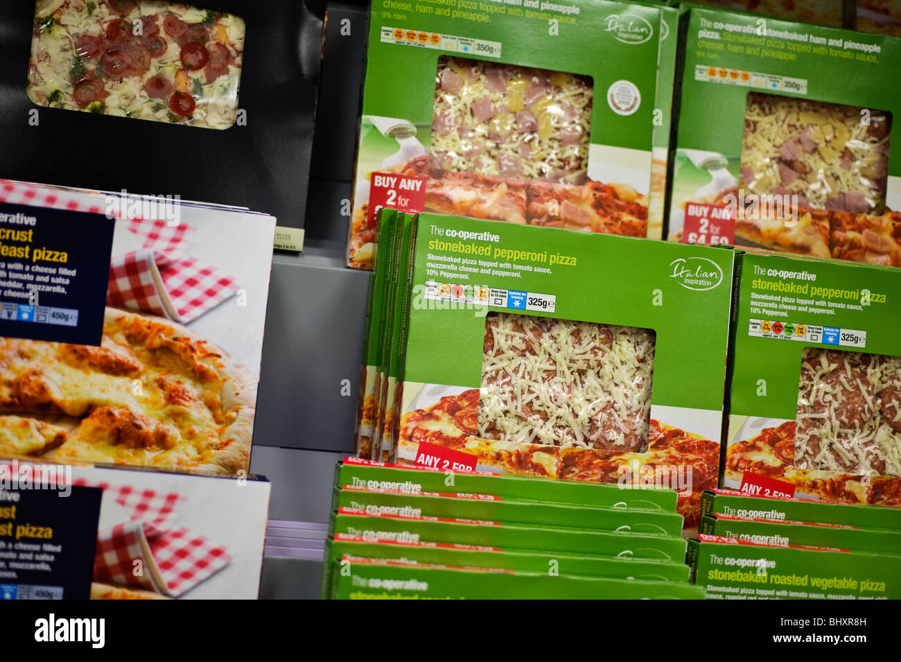 Boxes of pizza on sale on the shelves, Co-Operative Co-Op supermarket, UK - Stock Image
