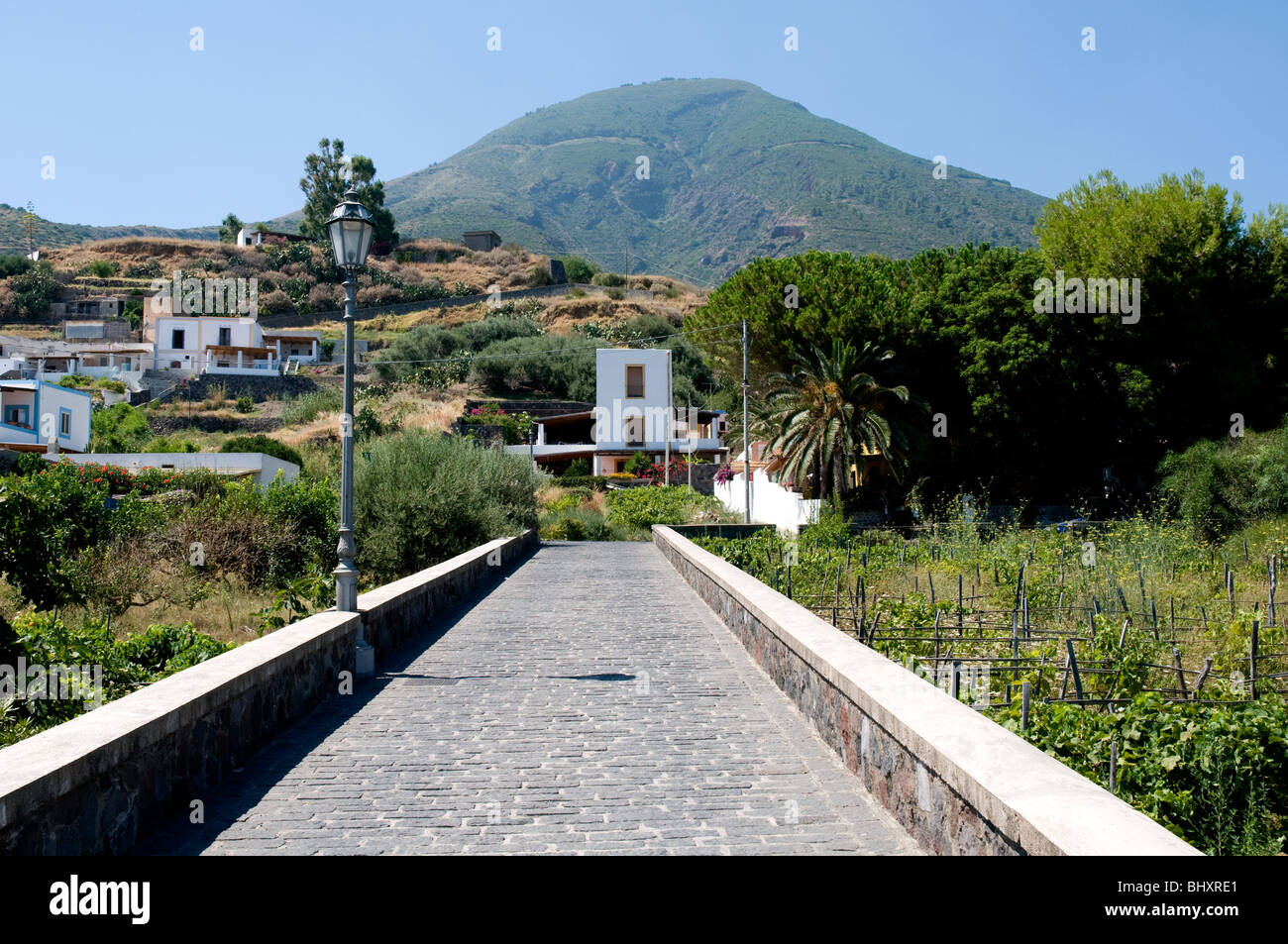A view of the village of Lingua and the dormant volcano of Monte Fossa delle Felci, on the Aeolian island of Salina, - Stock Image