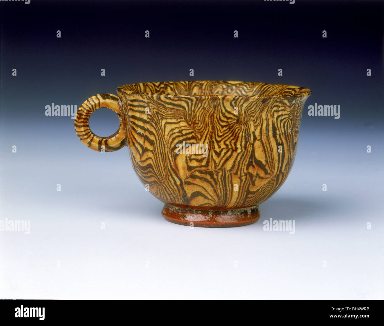 Brown marbleware cup, late Tang dynasty, China, 9th century. - Stock Image