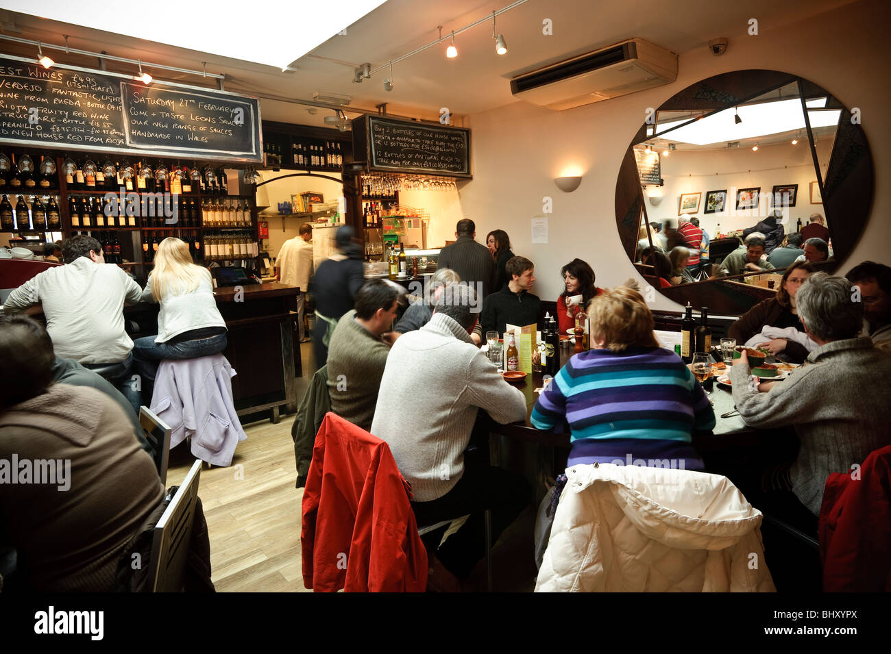 People eating lunch at Ultracomida Delicatessen and cafe tapas bar bistro, Aberystwyth Wales - Stock Image