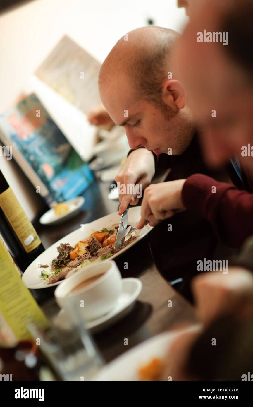 a man eating lunch at Ultracomida Delicatessen and cafe tapas bar bistro, Aberystwyth Wales UK. - Stock Image