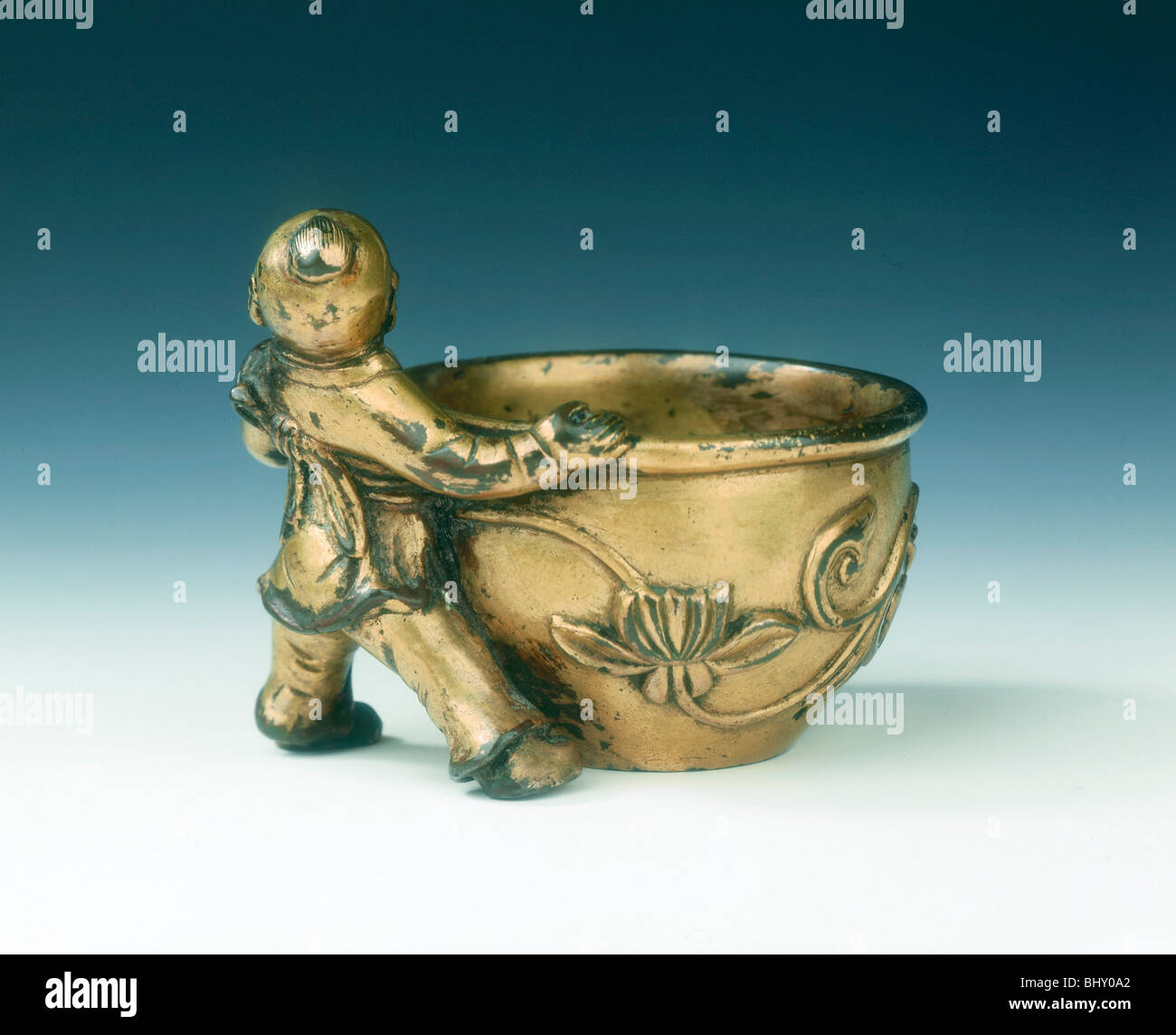 Gilt bronze water container with boy holding the rim, Ming dynasty, China, c early 16th century. Artist: Unknown Stock Photo