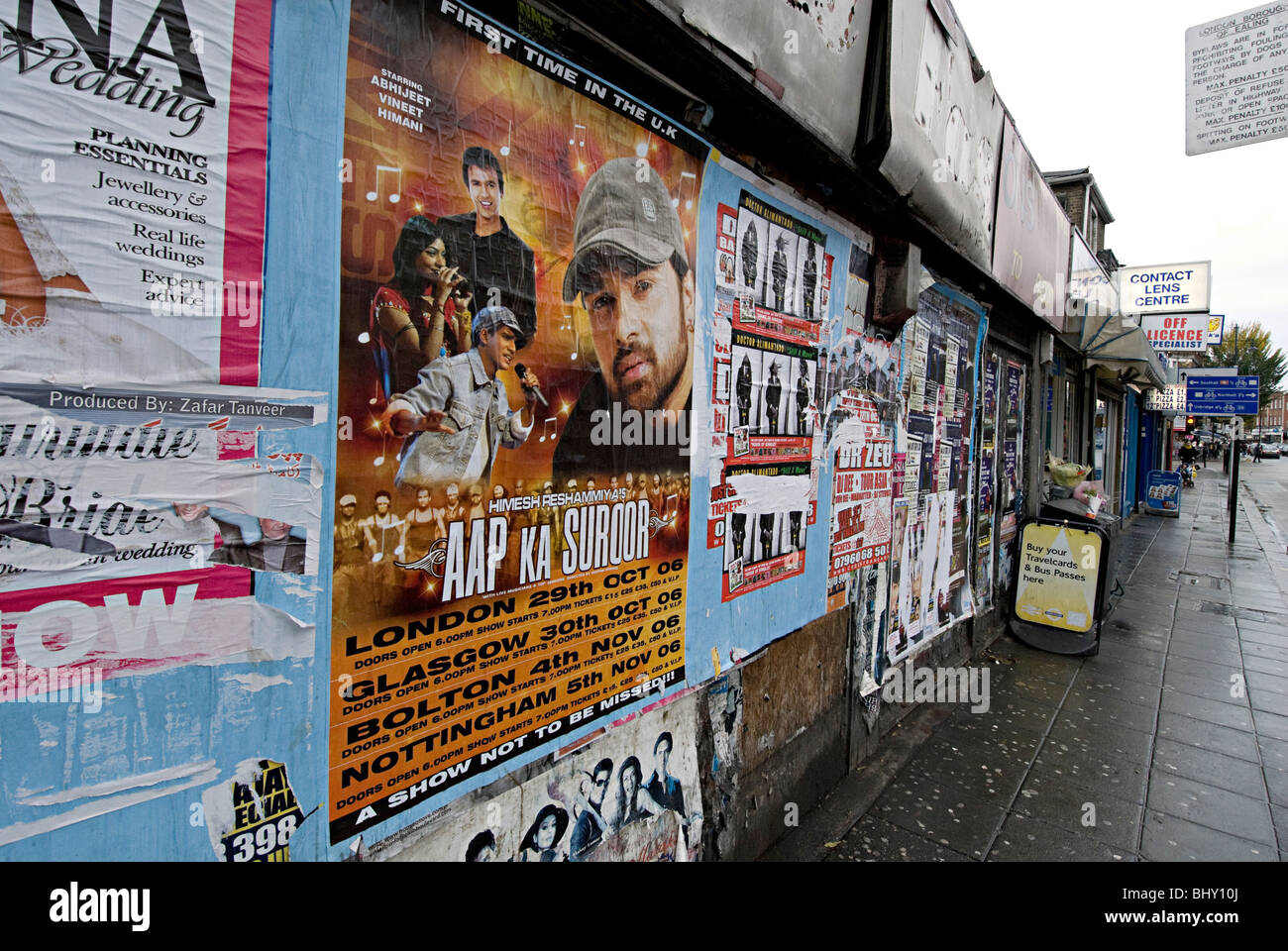 asian music posters plastered in the street in the uk to advertise indian and pakistani music - Stock Image