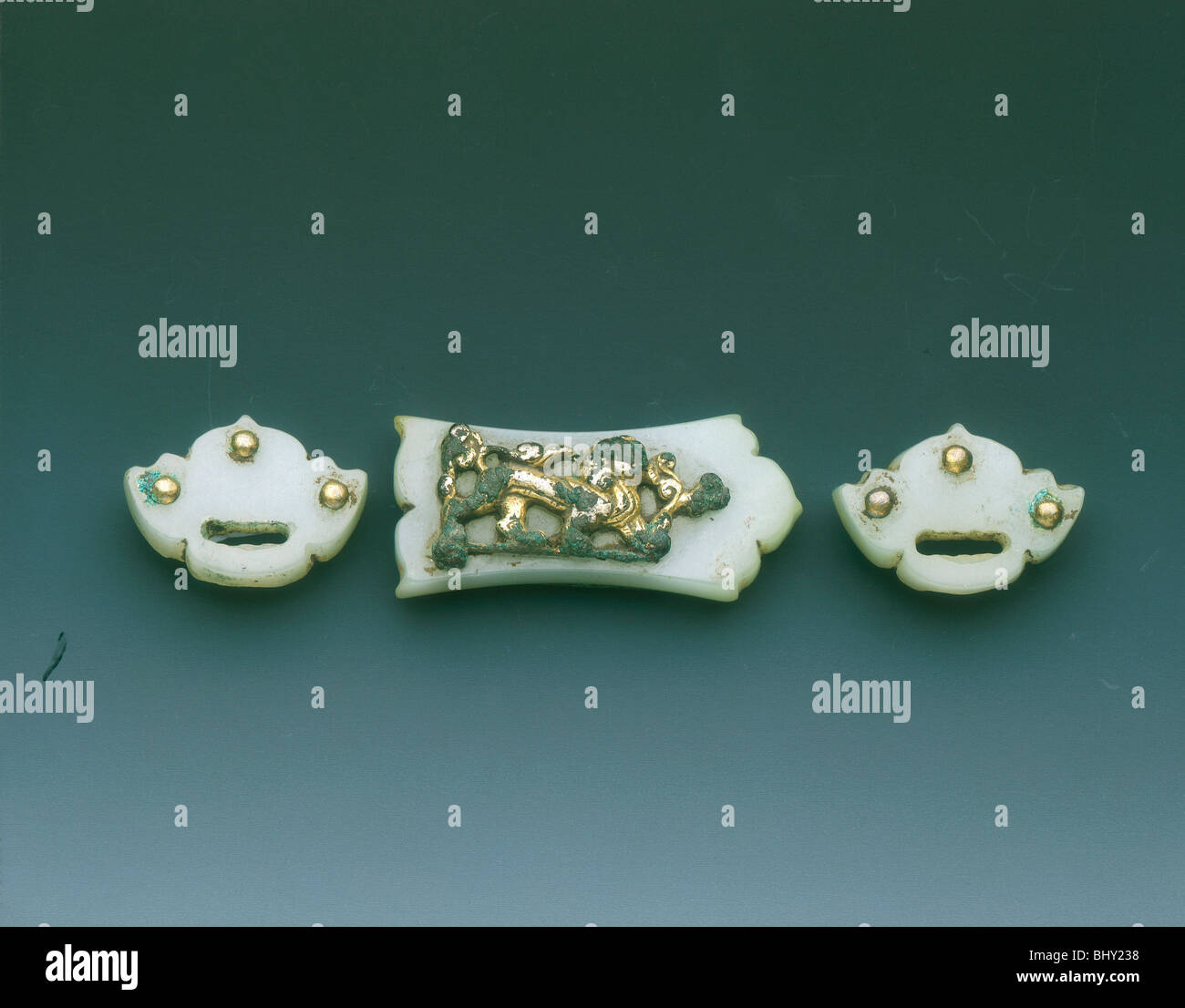 Gilt-bronze mounted group of three jade belt fittings, Liao dynasty or earlier, China, c907-1125. - Stock Image