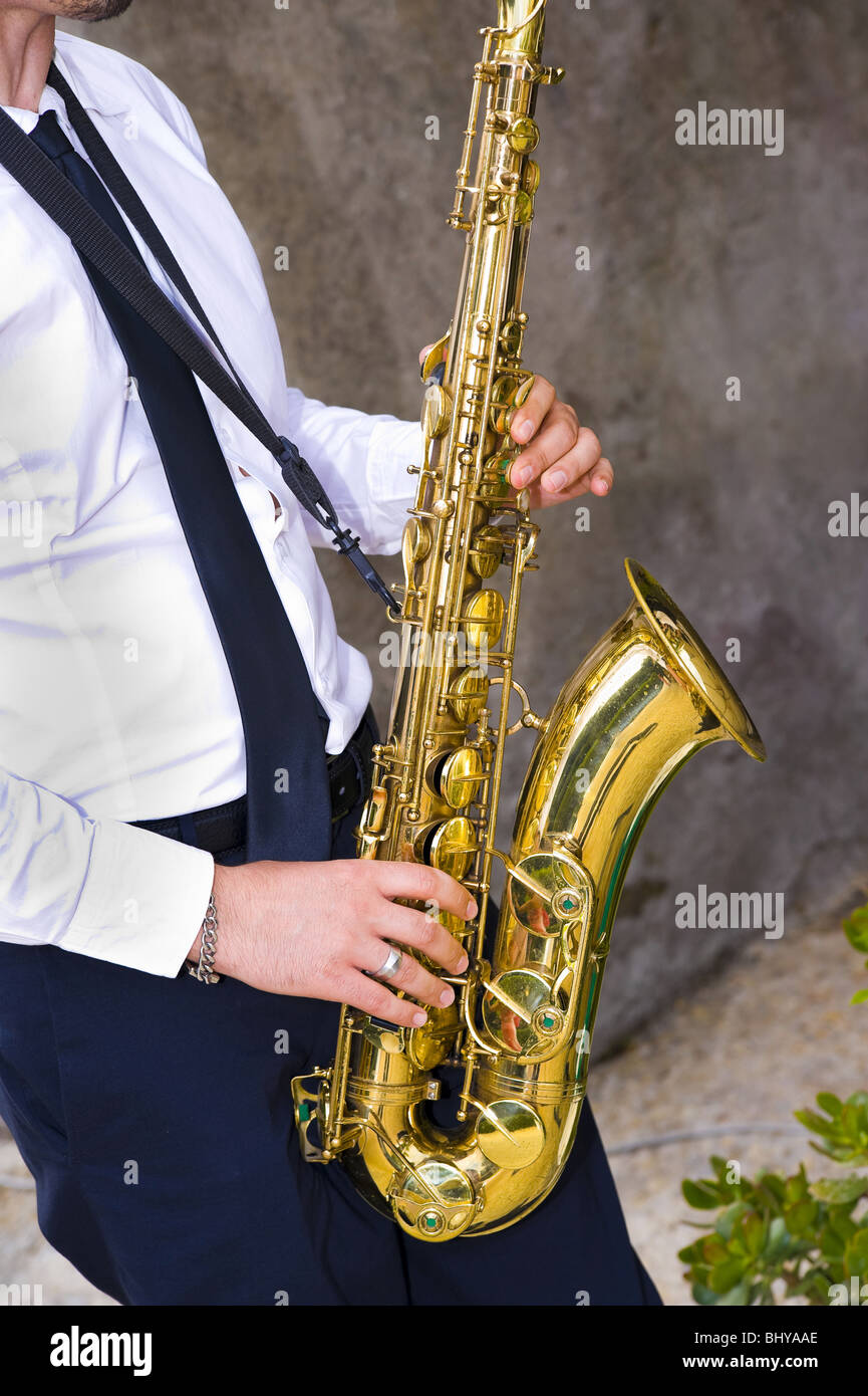Saxophone player playing music - Stock Image