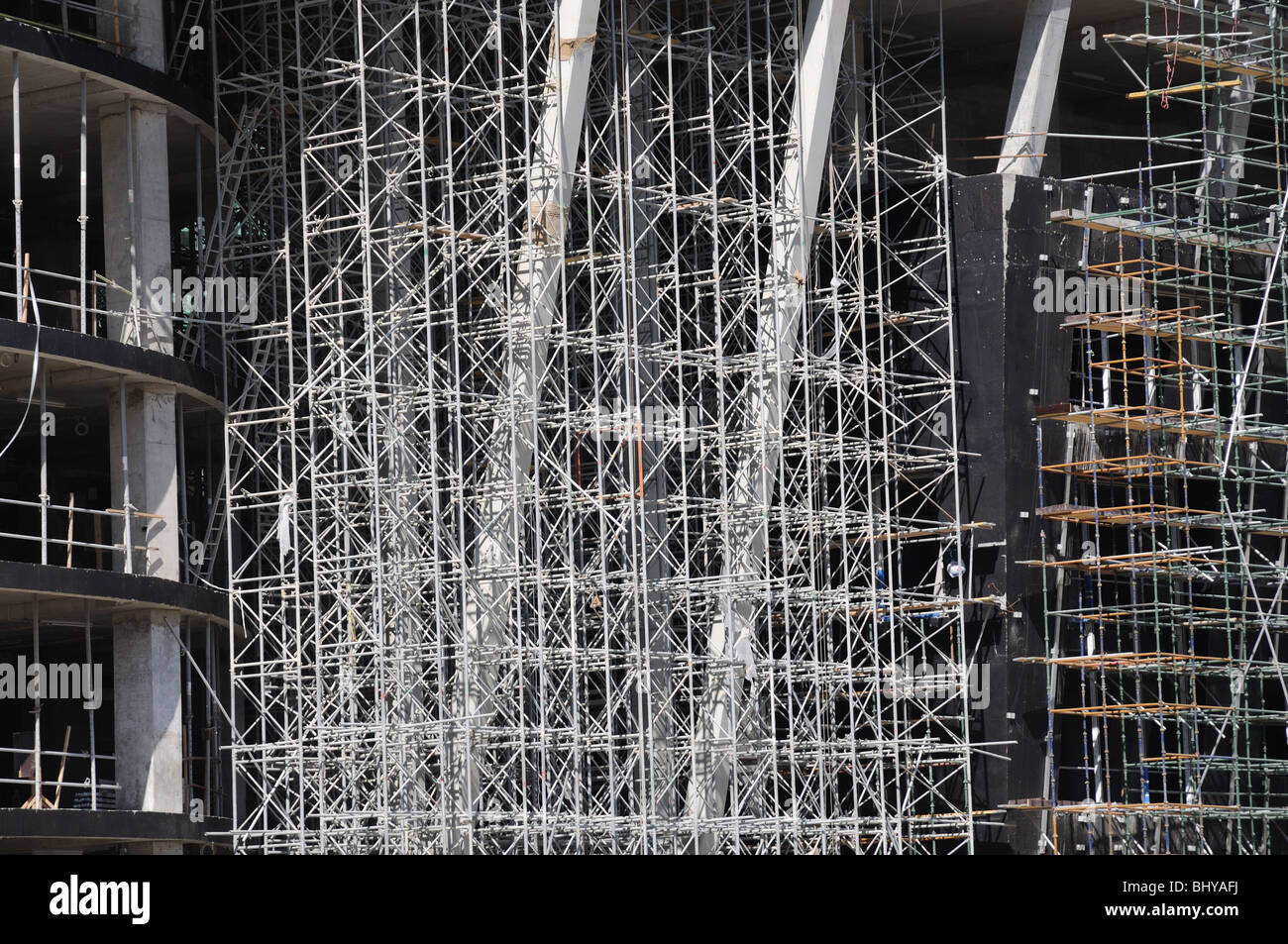 Scaffolding construction at new apartment building - Stock Image