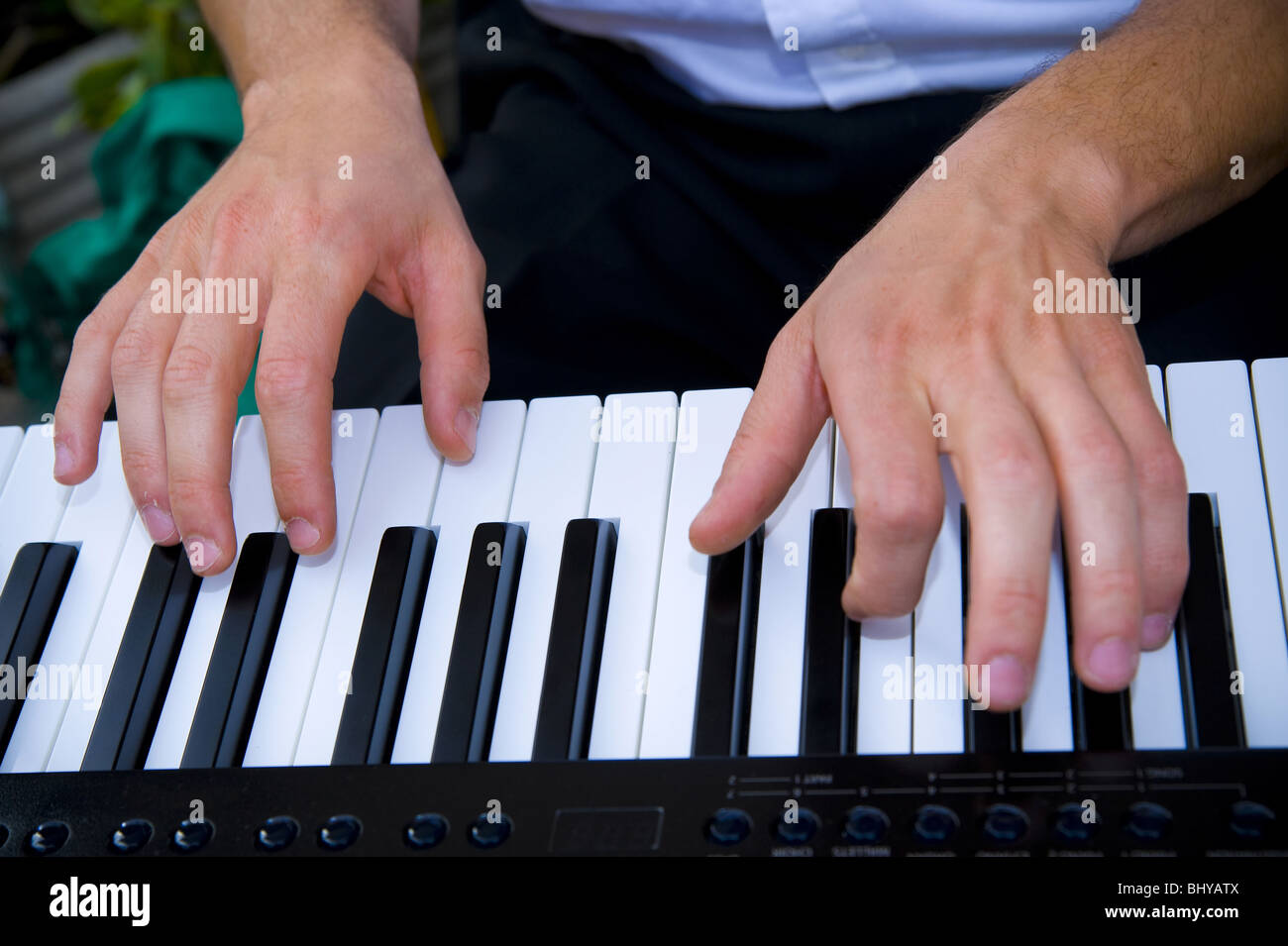 Hands playing piano - Stock Image