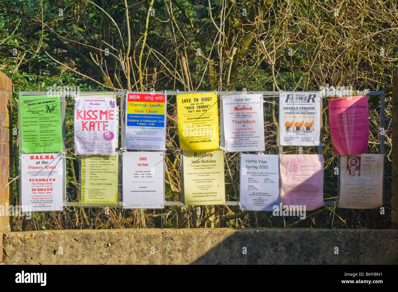 Pinner Middlesex , local outside noticeboard of events & amenities pinned on railings ie Jazz  , Kiss me Kate - Stock Image
