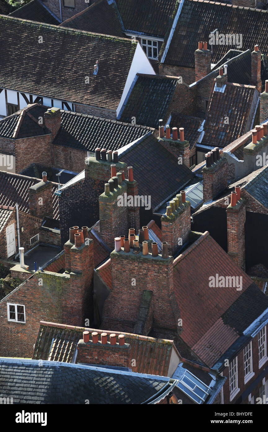 Aerial view of chimney pots and roof tops in York in North Yorkshire England Uk - Stock Image