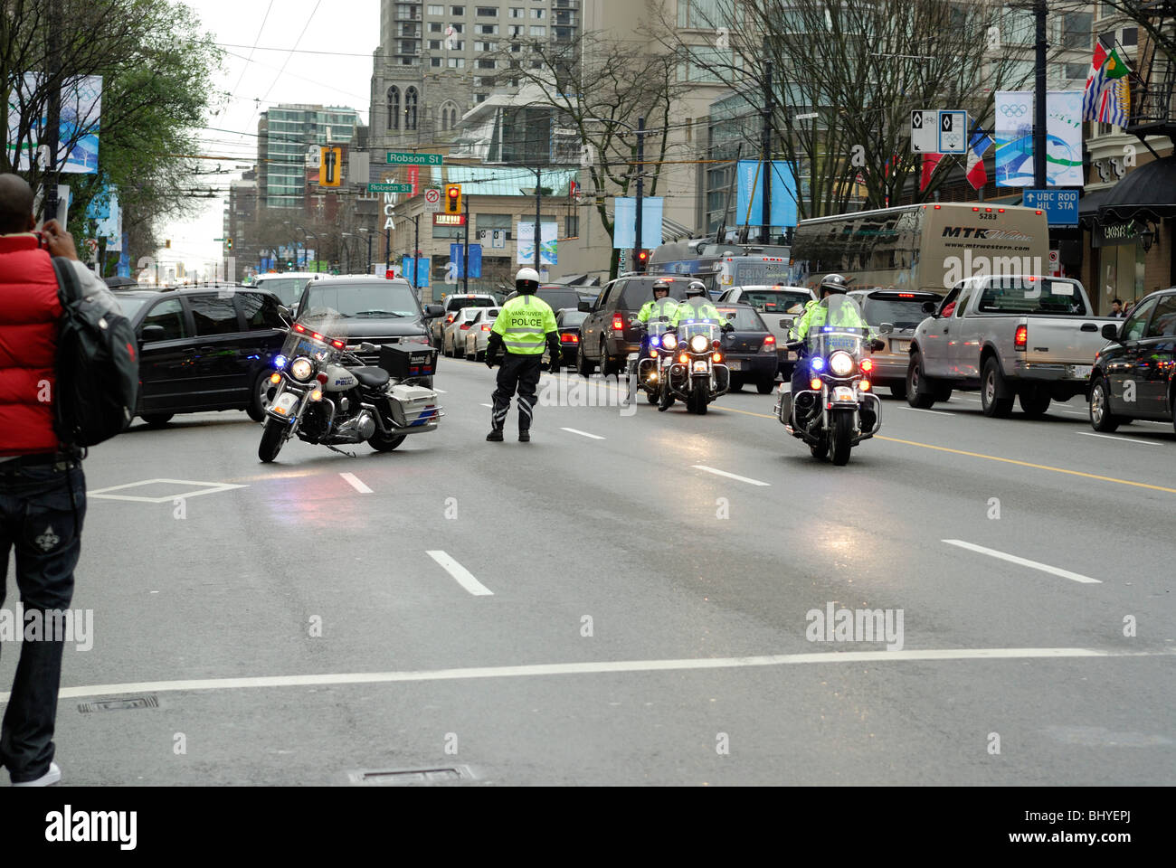 Vancouver Police clearing and blocking the roadway to allow officials and delegates easy access. - Stock Image