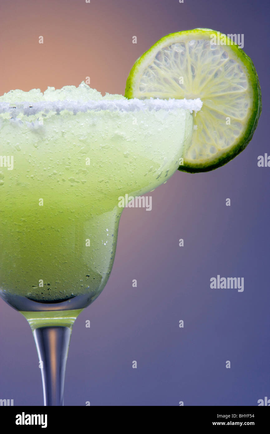 Frozen Margarita with Lime Garnish on Highlighted Background - Stock Image