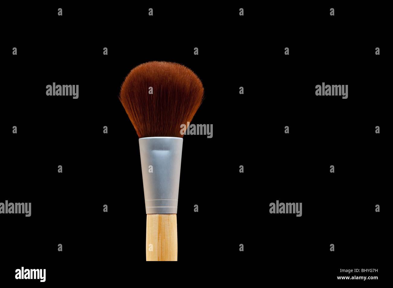 Horizontal close up of a make-up brush on black Stock Photo