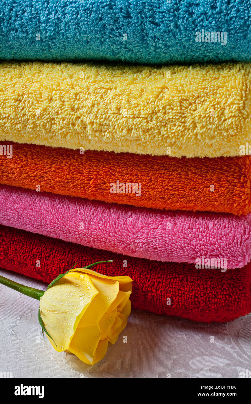 Yellow rose and stack of towels - Stock Image