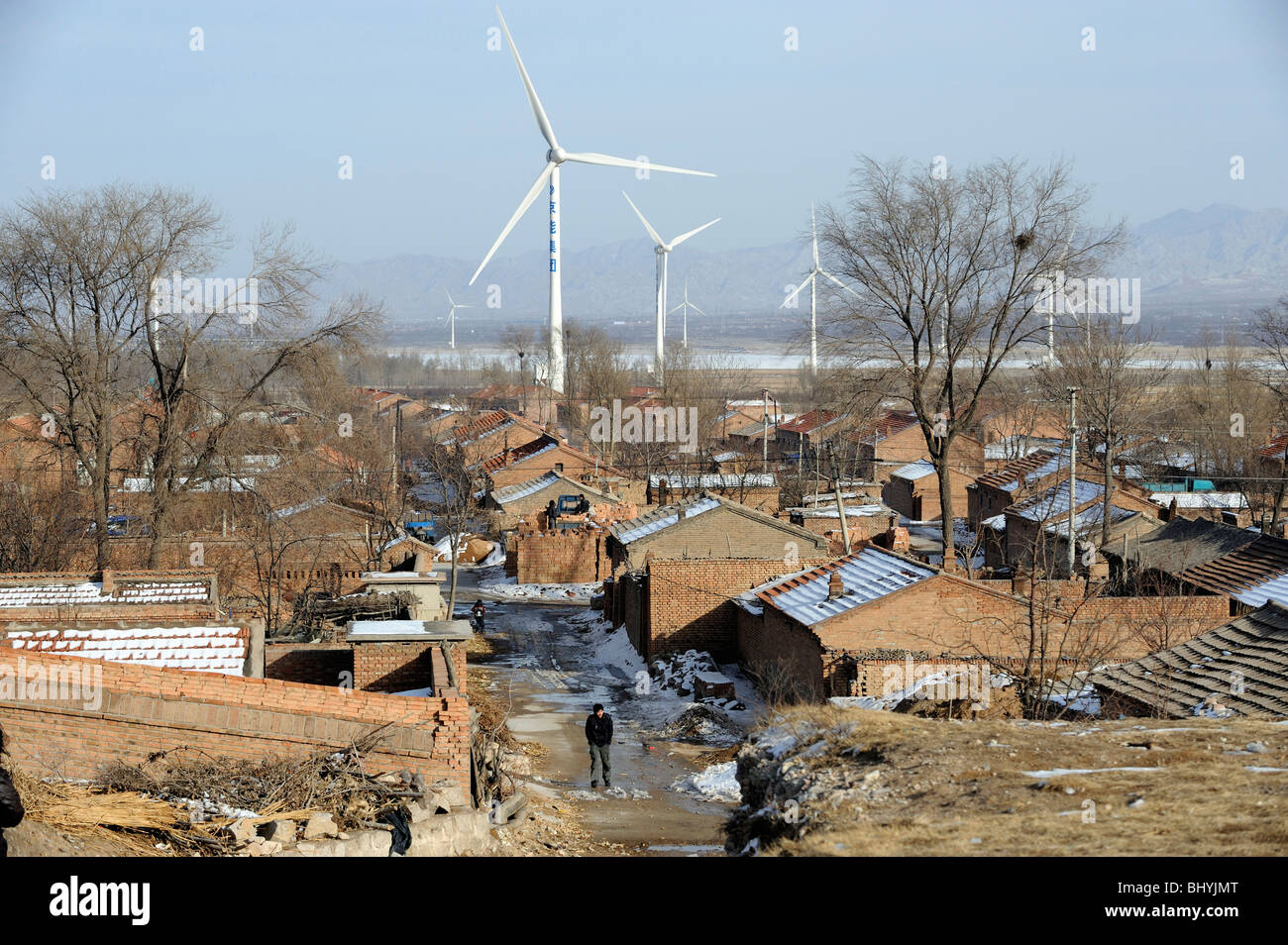 A village near Wind Farm in Huailai, Hebei, China. 02-Mar-2010 - Stock Image