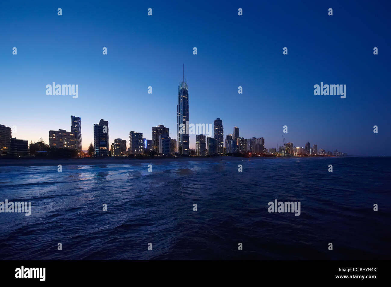 Surfers Paradise, Gold Coast Australia skyline at twilight  (low aerial view from a helicopter) - Stock Image