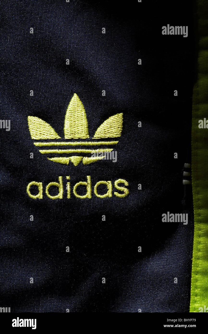 Adidas logo on tracksuit bottoms - Stock Image