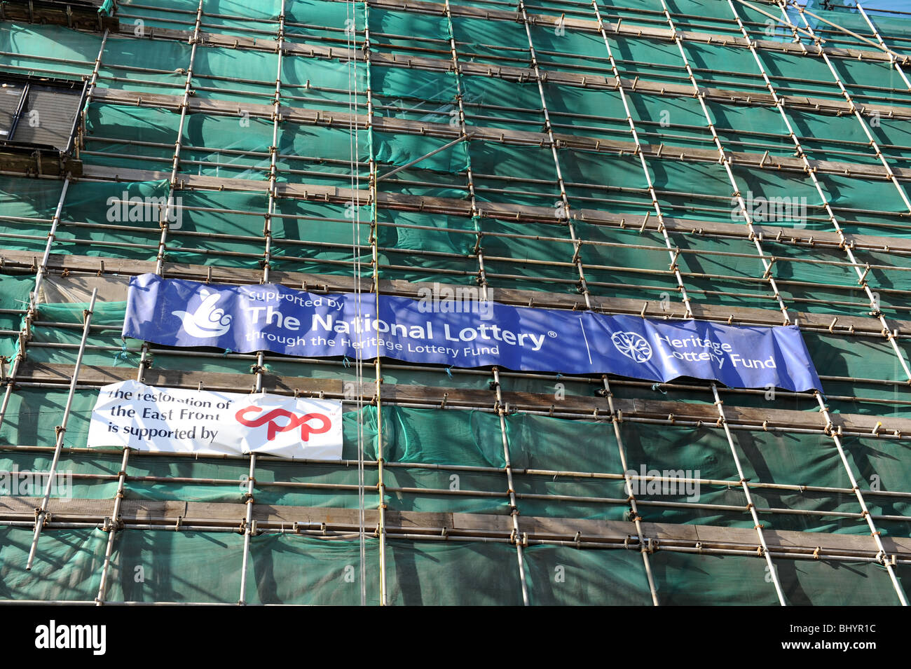 The National Lottery funding sign on scaffolding on York Minster in North Yorkshire England Uk - Stock Image
