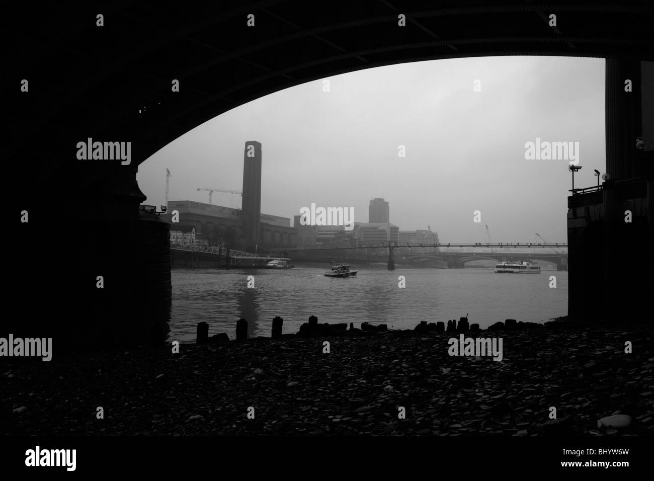 View of River Thames at Tate Modern and MIllennium Bridge from under Southwark Bridge, Bankside, London - Stock Image