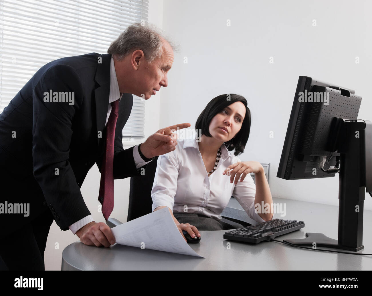 Male and female colleagues collaborating on a project - Stock Image