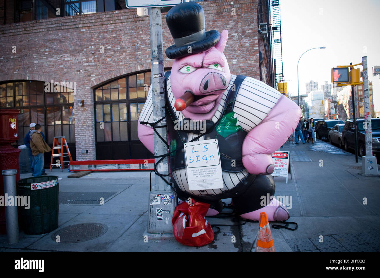 Giant inflatable capitalist pig outside Keith McNally's new restaurant Pulino's in the Nolita neighborhood - Stock Image