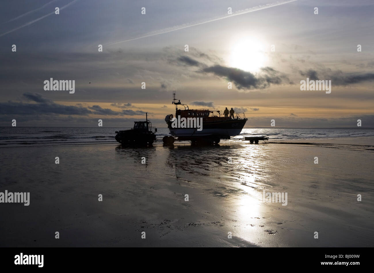 Early dawn Lifeboat Launch by Tractor, Clogher Head, County Louth, Ireland - Stock Image