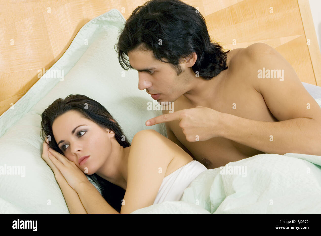 Couple disagreeing or arguing in bed Stock Photo