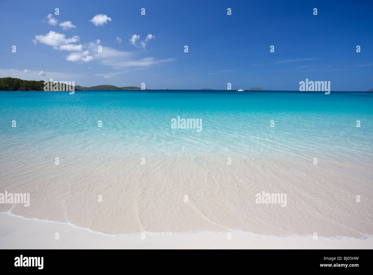 Gentle surf at a tropical beach in US Virgin Islands - Stock Image