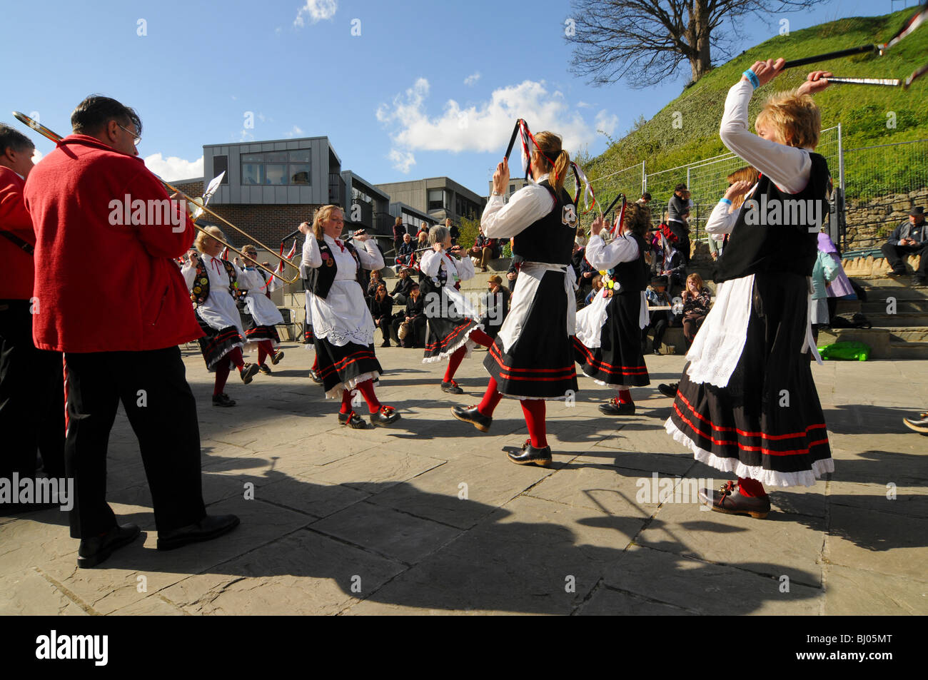 Morris dancers in action.  Mason's Apron, a northwest (clog) side dancing at the Oxford folk festival. - Stock Image