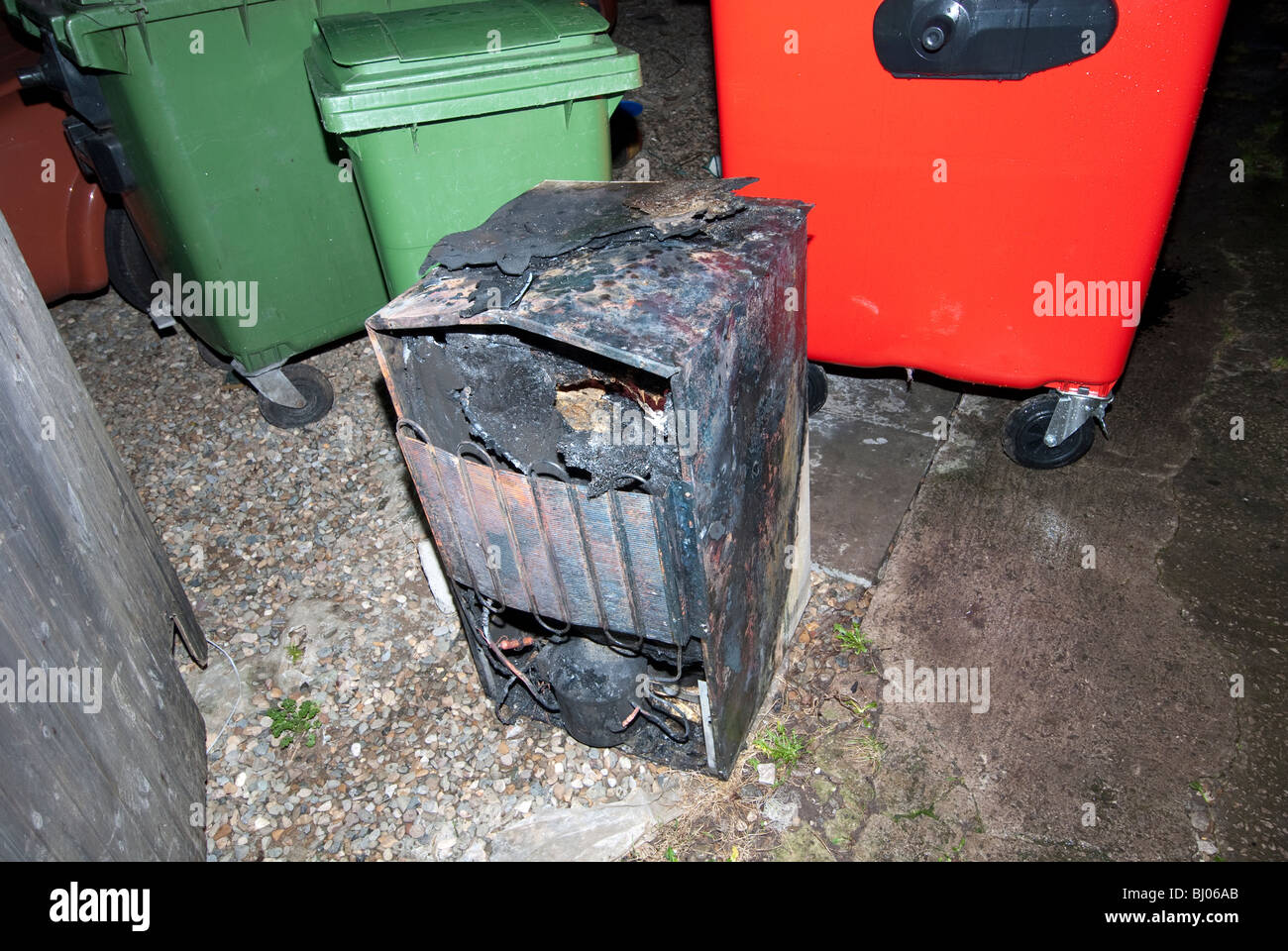 Household fridge burnt out following accidental fire - Stock Image