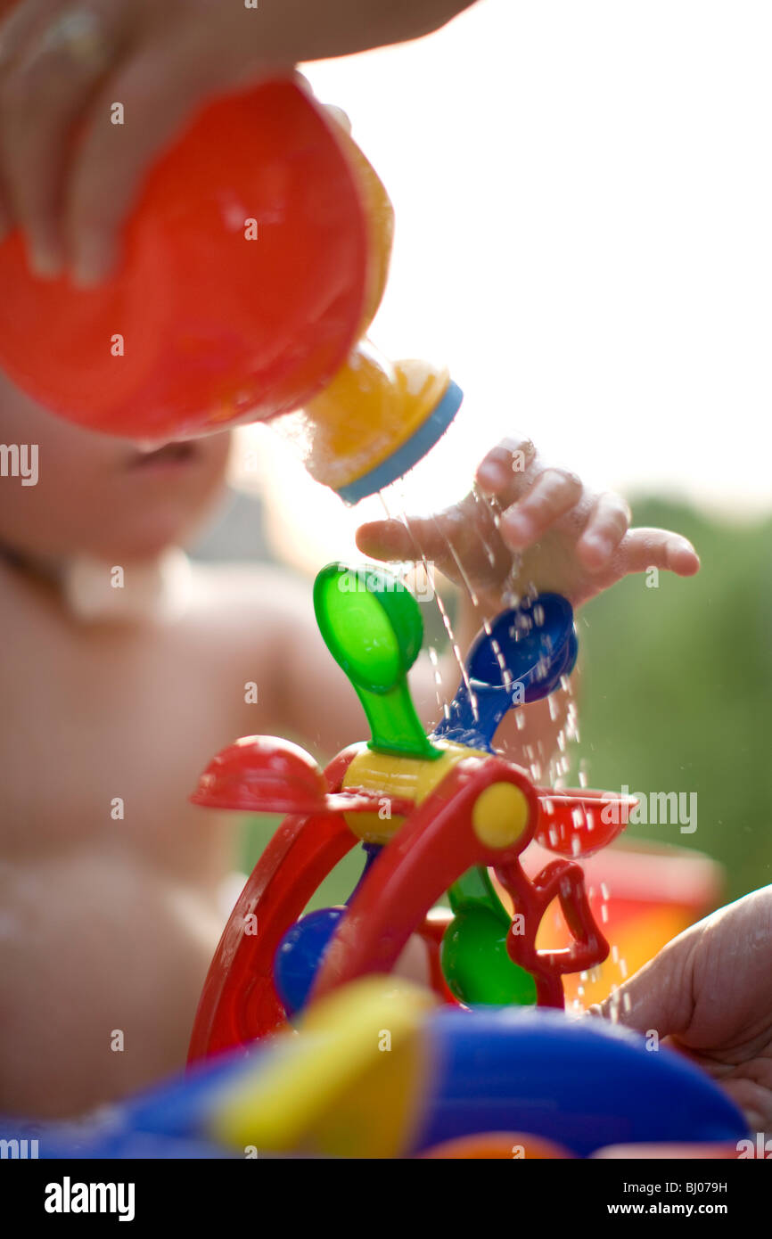 Boy playing with water toy - Stock Image