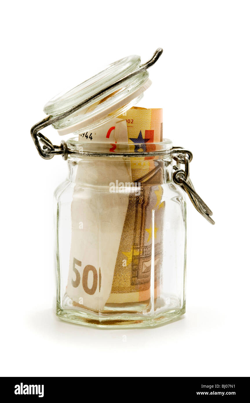 Jar filled with paper money on a white background Stock Photo