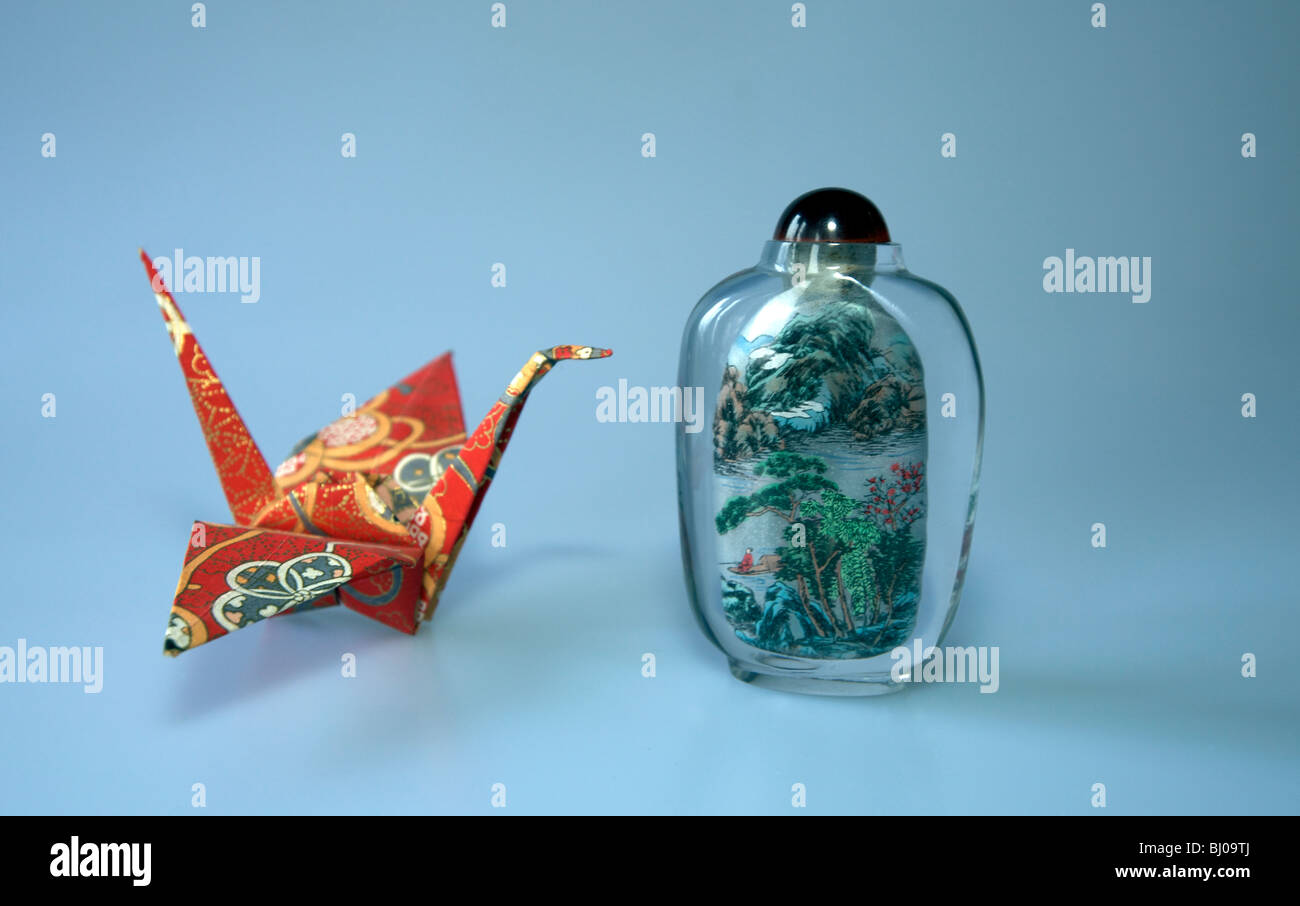 Origami crane and Chinese scent jar - Stock Image