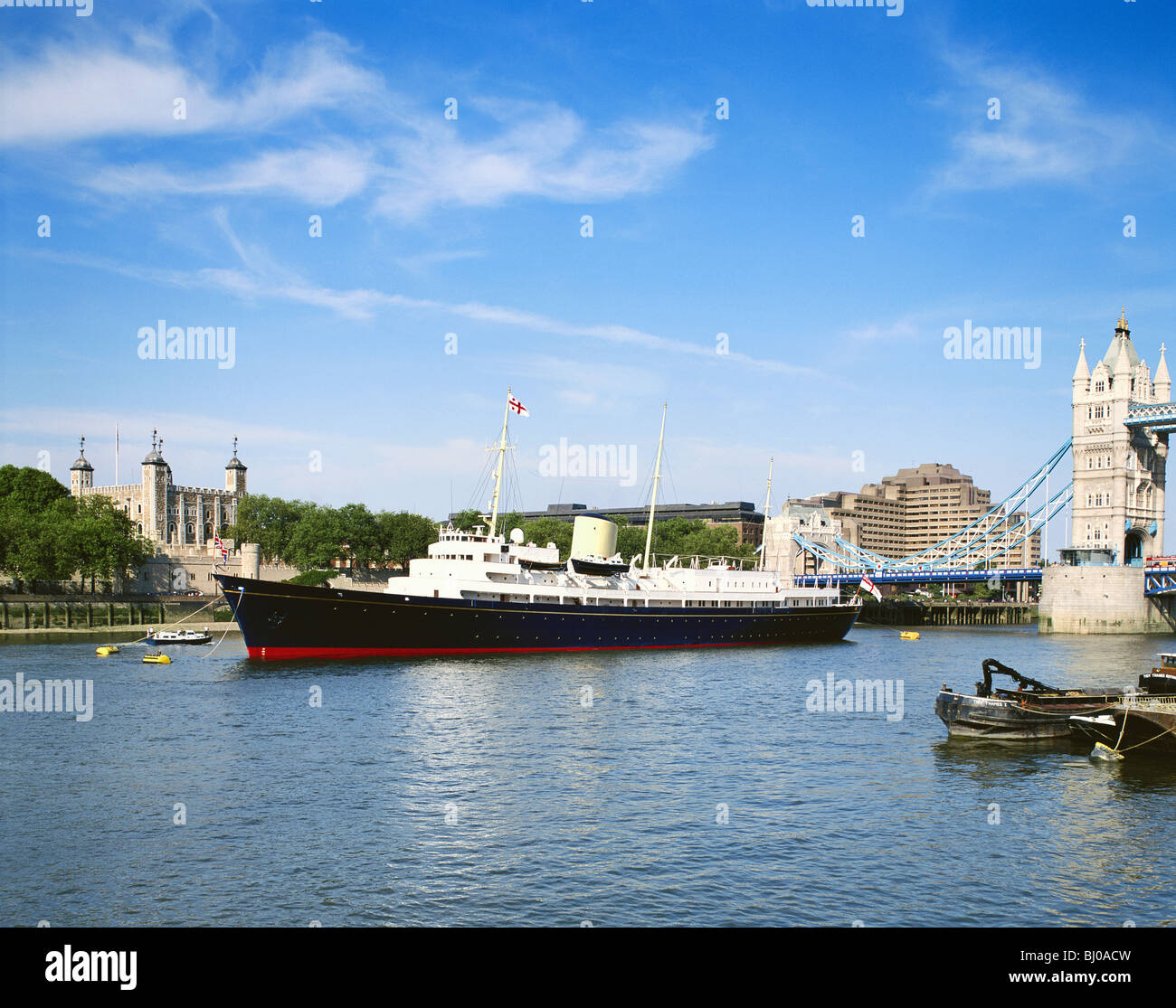 London, Royal Yacht  Britannia moored by the Tower of London and Tower Bridge, England, Britain, GB, UK - Stock Image