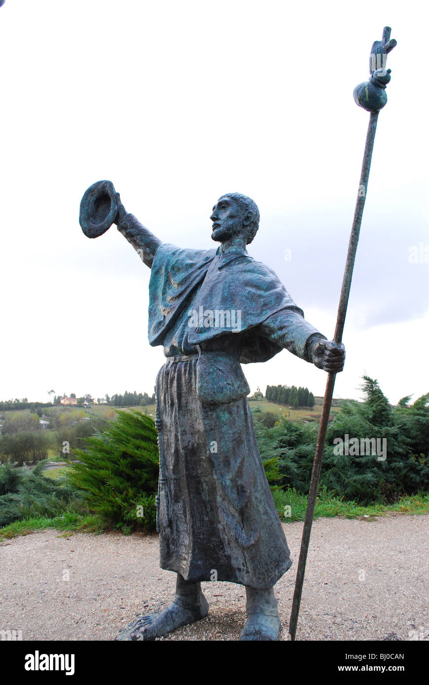 Sculptures of pilgrims at Monte do Gozo hailing Santiago de Compostela cathedral in the distance in Galicia, Spain. Stock Photo