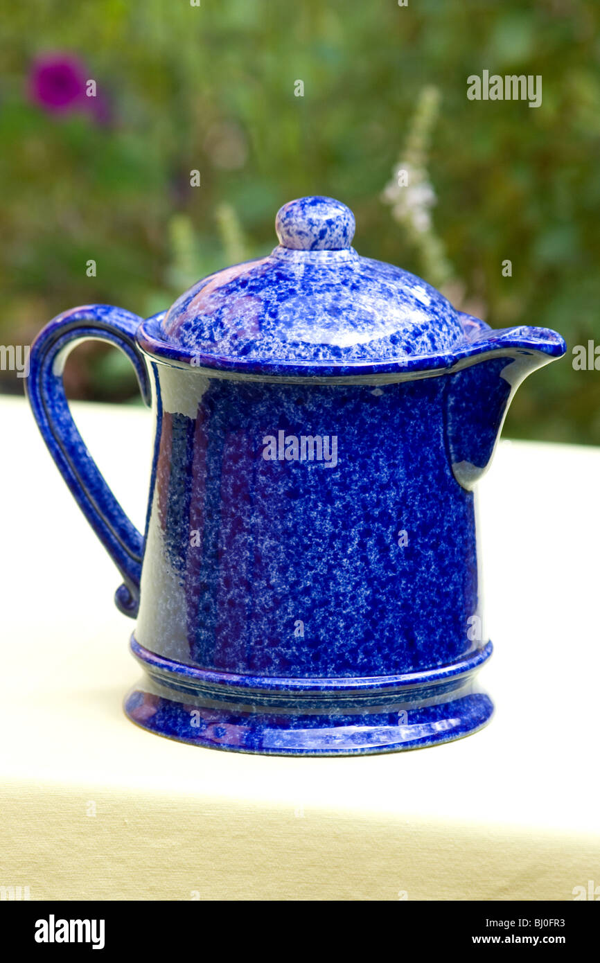 Close-up of blue tea pot on a table - Stock Image