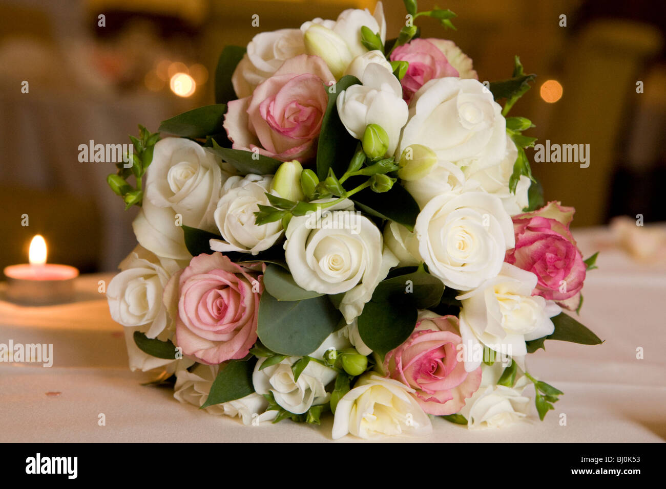 Bouquet Of Pink Cream And White Roses Flowers On A Wedding Table