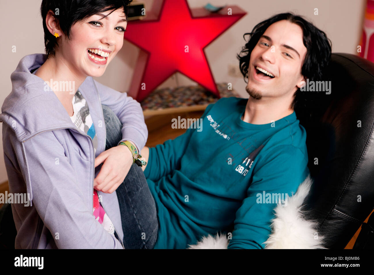 portrait of young couple at home - Stock Image