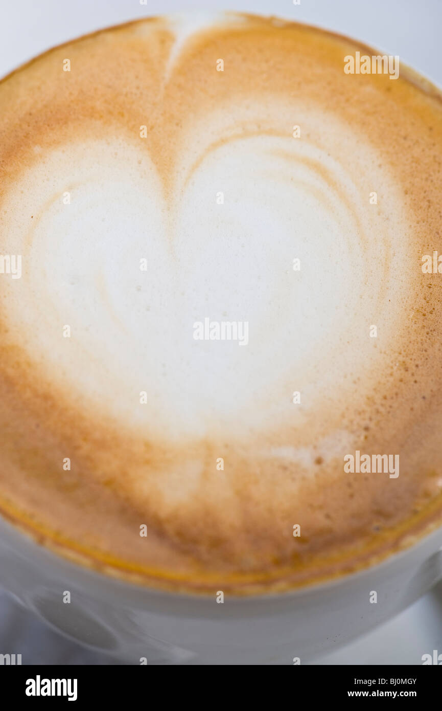 Close-up of the crema on a Capuccino - Stock Image