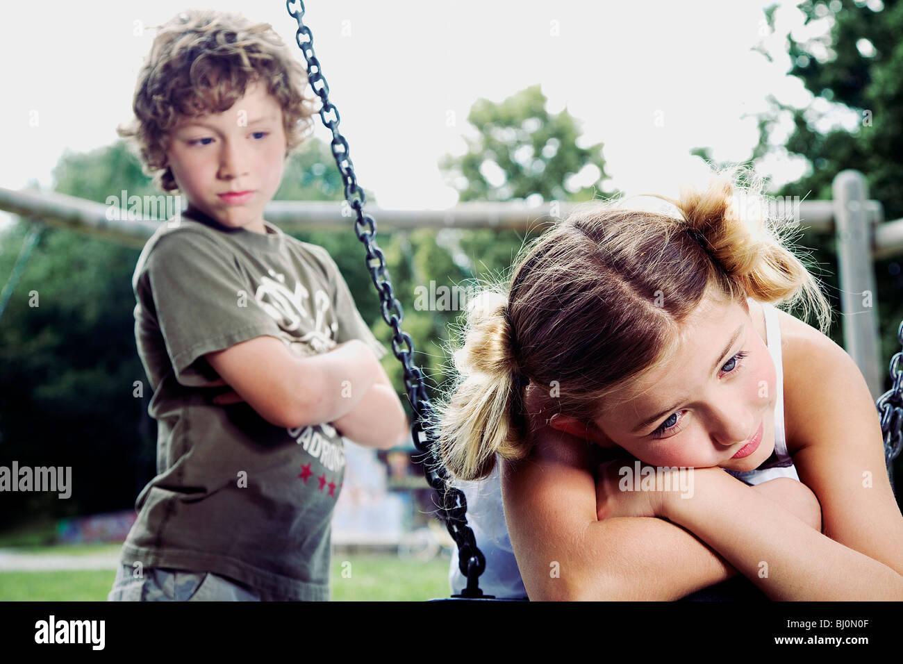 young boy watching sad girl at playground stock photo 28290655 alamy