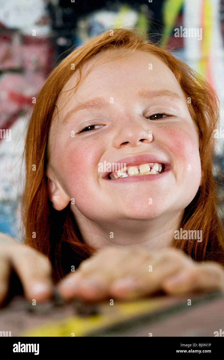 portrait of smiling red haired girl - Stock Image