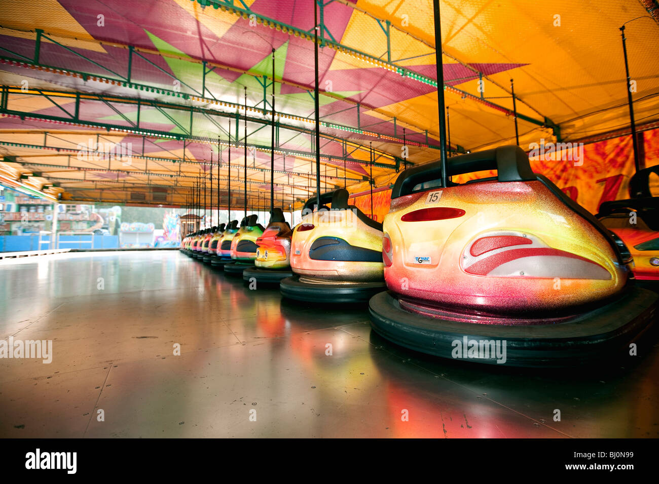 bumper cars lined up at the Munich Oktoberfest - Stock Image
