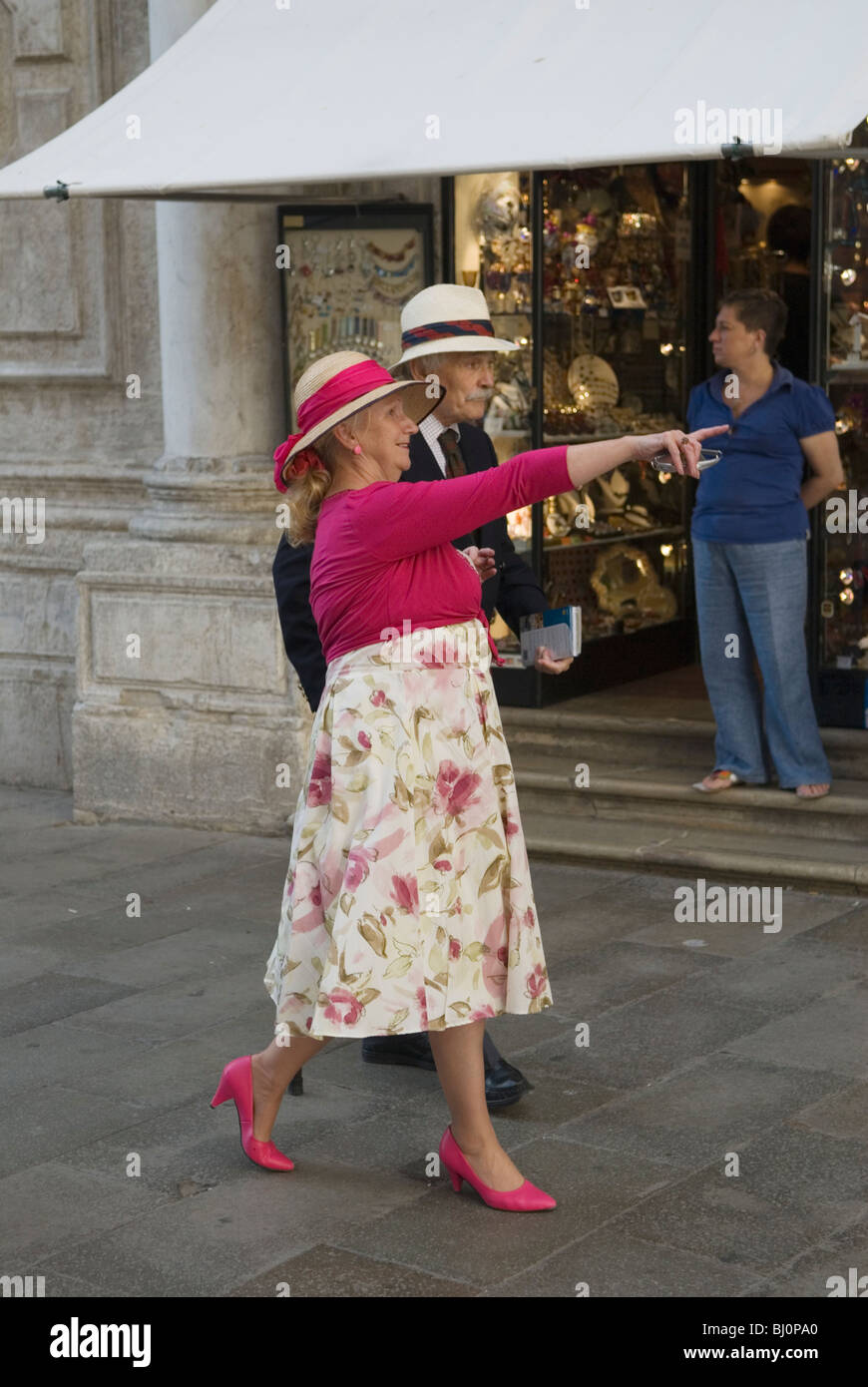 Venice Italy  British senior couple on romantic reliving their younger days holiday St Marks Square. - Stock Image