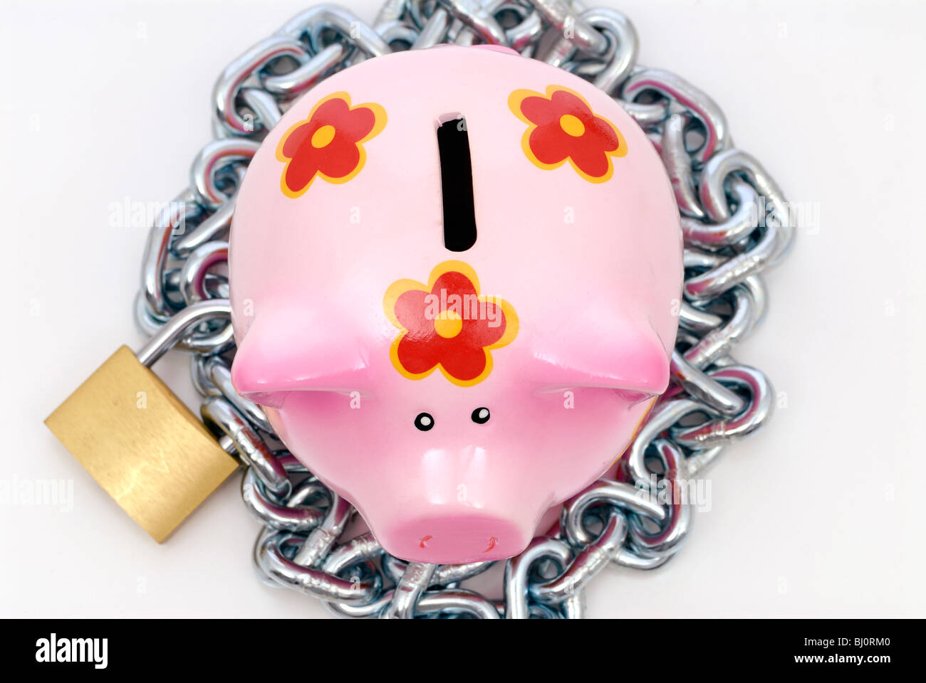 Piggy bank with an iron chain and padlock - Stock Image